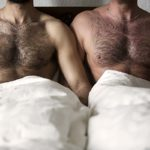 http://www.dreamstime.com/royalty-free-stock-photography-two-naked-men-hairy-chest-bed-closeup-image93941627