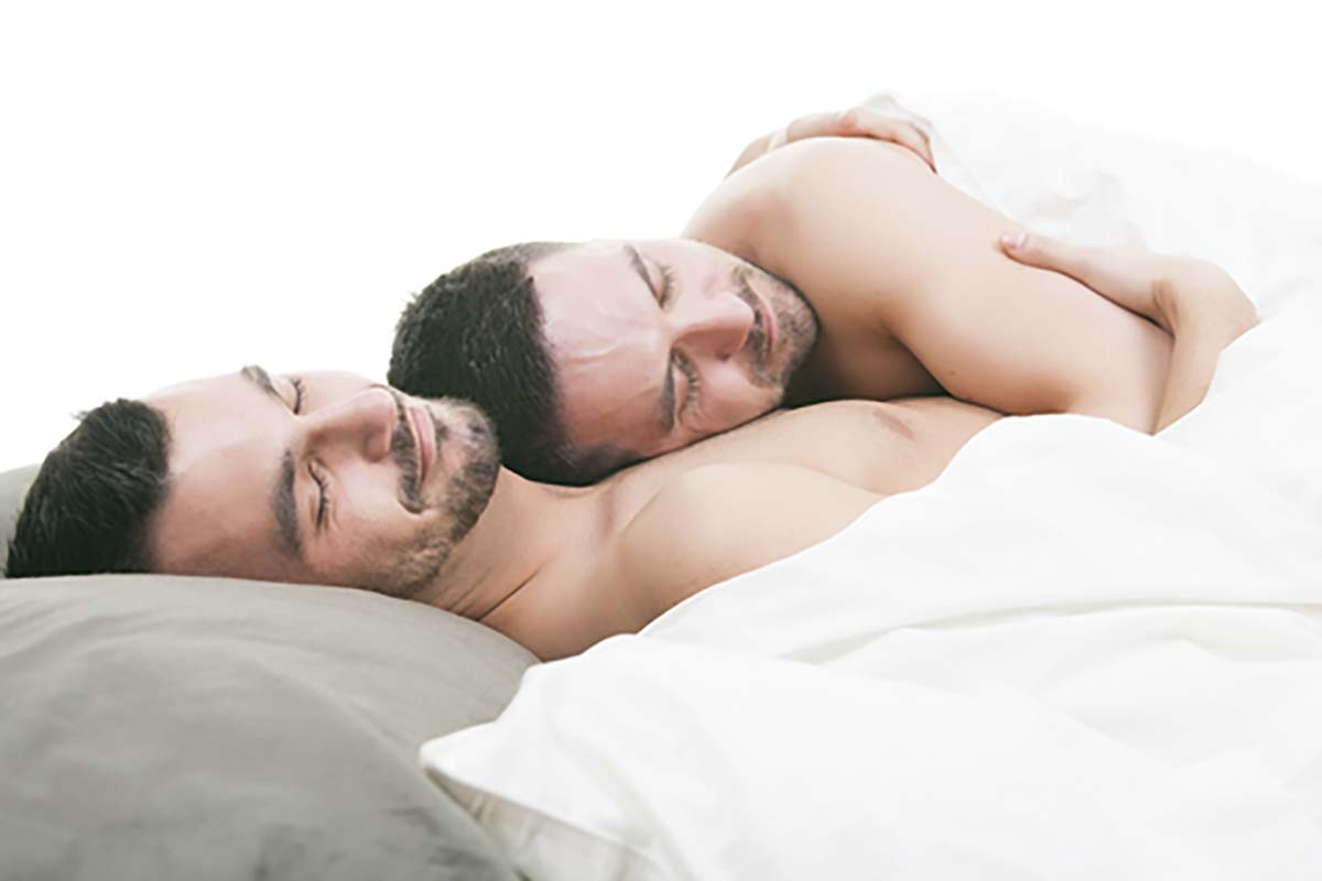 http://www.dreamstime.com/royalty-free-stock-image-homosexual-couple-onder-bed-studio-white-image54082096